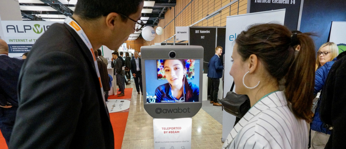 Modern technology - including telepresence and machine translation - is driving a new era of globalization. Image: REUTERS/Robert Pratta